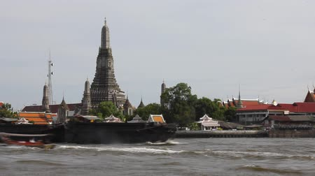 Sailing boat passes in front of the pagoda