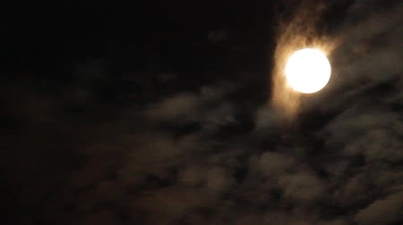 perigee : The full moon, supermoon which clouds flitter accross, Seoul, Korea Stock Footage