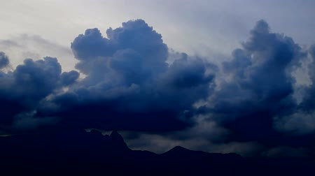 grotesque : dark blue clouds scud across the sky over mountain, edited, Seoul, Korea, fast forward 9x Stock Footage