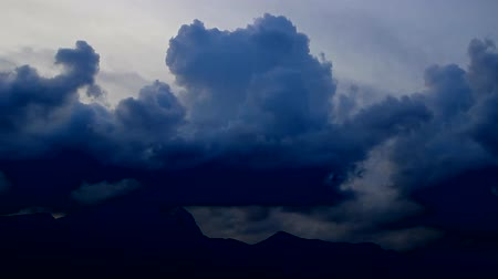 grotesque : clouds scud across the sky over mountain, edited, Seoul, Korea, fast forward 45x