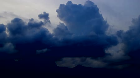 grotesque : clouds scud across the sky over mountain, edited, Seoul, Korea, fast forward