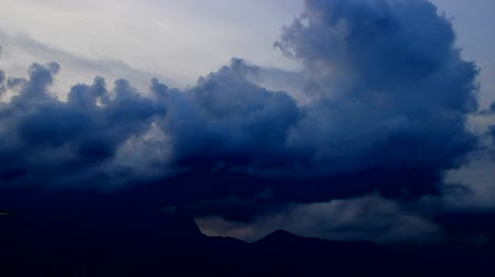 grotesque : clouds scud across the sky over mountain, edited, Seoul, Korea, fast forward 9x Stock Footage
