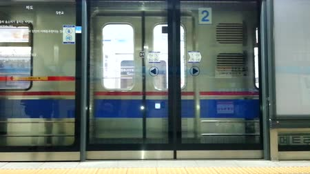 subway : Seoul subway train stop and door open at subway starion, Seoul, Korea, with sound, 5sec