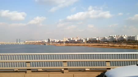 traverse : Crossing the Han river, large bridge, sideview, Seoul Korea