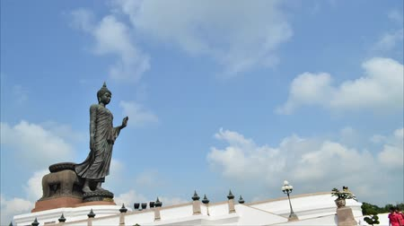 budist : Buddha and set against the sky with clouds moving