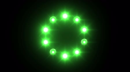 video effects : light loading wheel - 30fps flickering loop - green lights shining on black background, animated rays Stock Footage