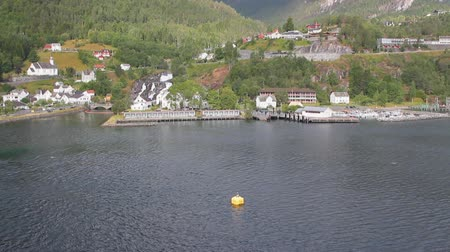 port n : Water area of ??port and settlement ashore. Hellesylt, Norway Stock Footage