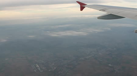 Under plane wing land surface and clouds. Frankfurt am Main, Germany Stockvideo