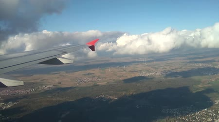 main : Plane wing, land surface and clouds at decrease. Frankfurt am Main, Germany