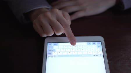 non us location : Woman Typing on Tablet Stock Footage