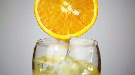 orange : orange juice poured into a glass