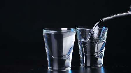 ginástico : alcohol vodka poured in glasses on a dark background Stock Footage