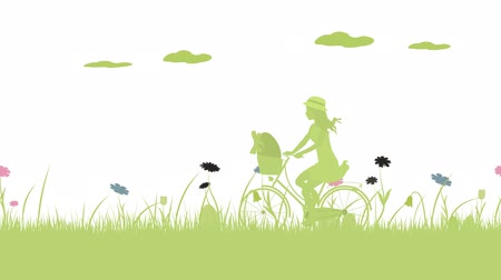 motif : Happy Easter. Field with girl on bicycle, Easter eggs, butterfly and flowers. Stock Footage