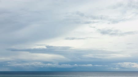 time lapse clouds : moving grey clouds over sea horizon time lapse Stock Footage