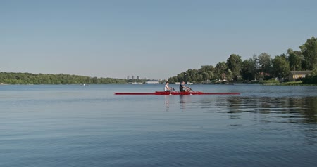 kano : Young sports team two teenage boys with a double boat kayak on the water