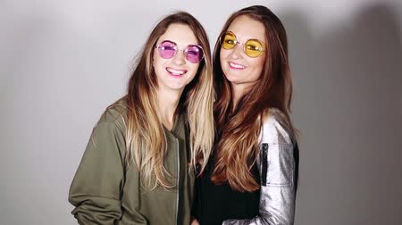 abriu : Girlfriends in colorful sunglasses making fun faces, emotionally posing.