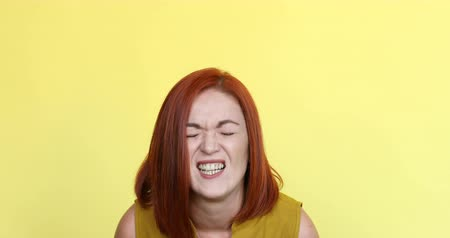 hatred : Beautiful ginger woman screaming and looking at camera.