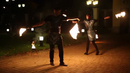 chamejante : Activity couple dancing and showing with fire at night time.