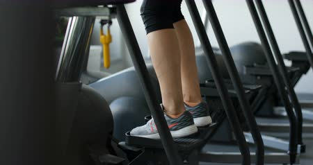 Back view of fitness woman running on treadmill. Stok Video