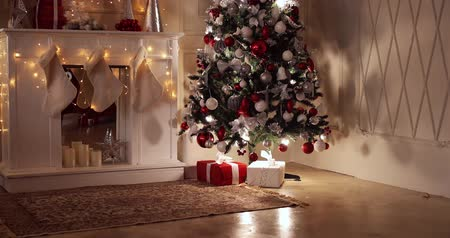 Children with Christmas presents under the Christmas tree. Dostupné videozáznamy