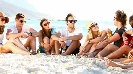 teenager : Young hipster people enjoying a beach party with guitar music