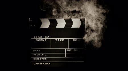 film slate : Film slate being clapped in slow motion with a cloud of chalk dust