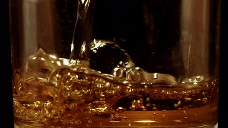 pálinka : Whiskey poured into glass in slow motion Stock mozgókép