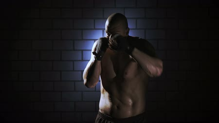 lutador : Kickboxer shadow boxing as exercise for the big fight, shot on Red Epic