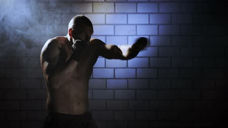 sportovní : Kickboxer shadow boxing as exercise for the big fight, shot on Red Epic