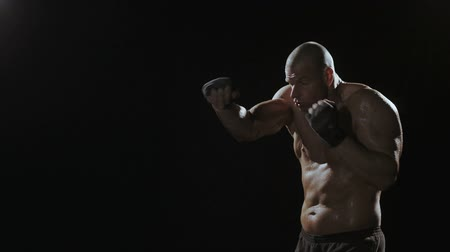boxe : Kickboxer shadow boxing as exercise for the big fight, shot on Red Epic