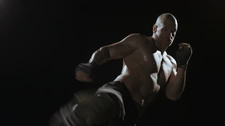 sport : Kickboxer shadow boxing as exercise for the big fight, shot on Red Epic