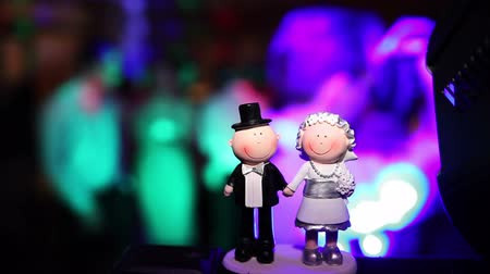 wedding cake : Wedding couple figures on cake during party Stock Footage
