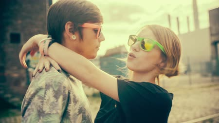 genç çift : Teenage hipster boyfriend and girlfriend having fun in the sun with vintage color correction Stok Video