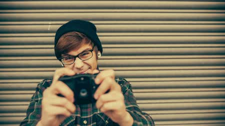 hipster : Hipster taking pictures with old vintage camera in grunge color correction