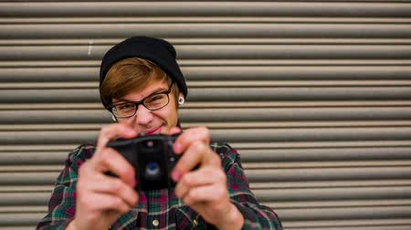 hipster : Hipster taking pictures with old vintage camera Stock Footage