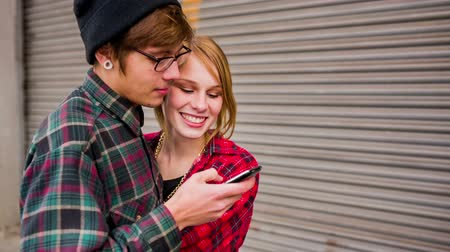 hipster : Hipster couple using smartphone and laughing Stock Footage