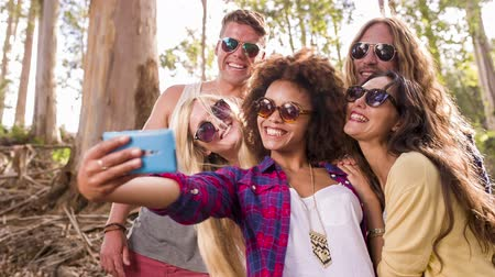 hippi : Hipster group is taking selfies Stock mozgókép
