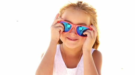 sassy : Girl with sunglasses is goofing around Stock Footage