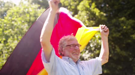 almanca : Old Man with German Flag held high