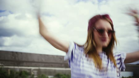 hipster : Girl showing heart and victory sign to camera Stock Footage
