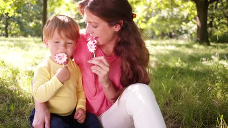 curto : Mother and son enjoying i love you lollipops