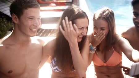 веселье : Friends taking selfie with phone at poolside