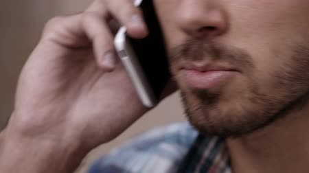 ağız : Close up of young man enjoying conversation on phone