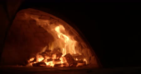 gourmet : traditional wood fire pizza oven with flames in slow motion Stock Footage