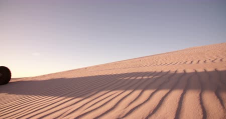 atv : Pro quad biker driving on a sand dune while involved in a desert race in Slow Motion