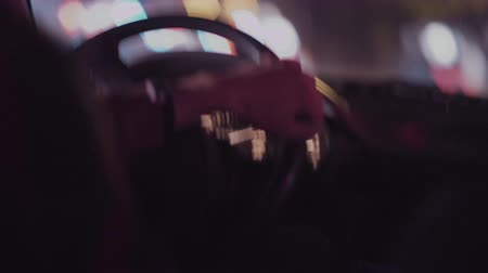 inside car : Interior view of a man driving his private taxi through the city streets at night