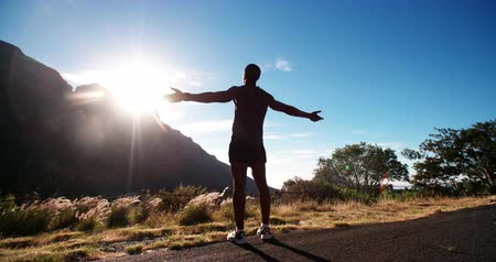napos : Slow motion Athlete enjoying the early morning sun on a mountain road while exercising and keeping fit