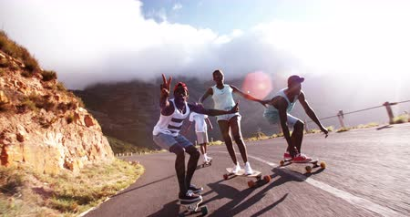 longboarder : Teen African American guy pulling a face on his longboard in Slow Motion Stock Footage