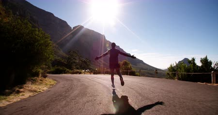 jogging : Athlete running in slow motion on a road in the morning expressing joy and triumph