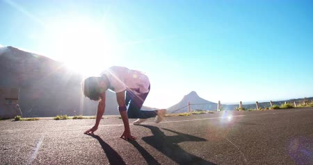 menő : Teenager practicing some flexible breakdancing in a road in slow motion Stock mozgókép